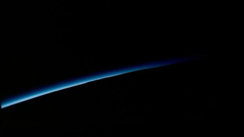 "Orbital sunset photographed by astronaut John H. Glenn Jr. aboard the ""Friendship 7"" during his Mercury-Atlas 6 (MA-6) spaceflight."