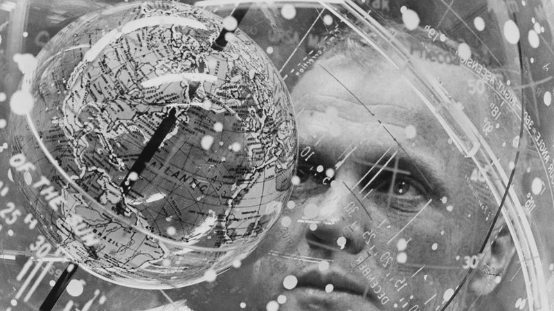 Astronaut John H. Glenn Jr. looks into a Celestial Training Device (globe) during training in the Aeromedical Laboratory at Cape Canaveral, Florida.