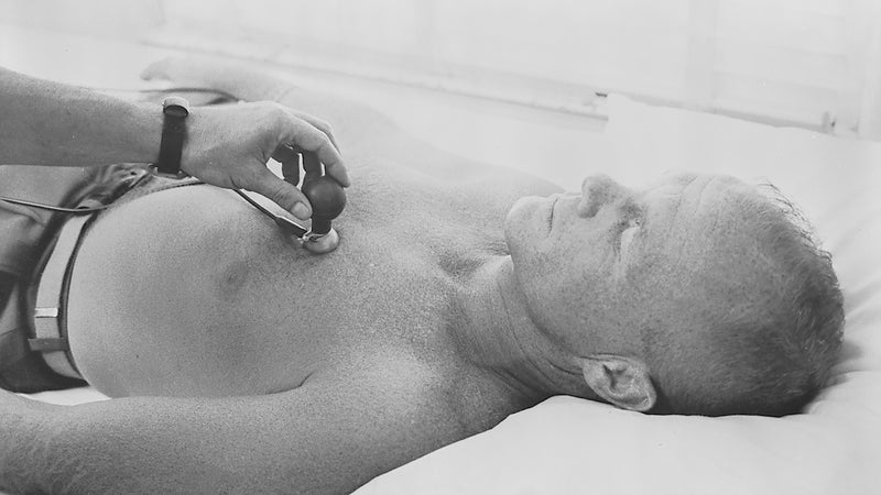 Mercury astronaut John H. Glenn Jr. has a biosensor attached to his body during astronaut training activities at Cape Canaveral, Florida.