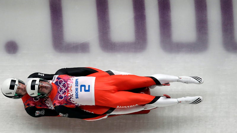 The doubles team of Andreas Linger and Wolfgang Linger of Austria speed down the track in their final run during the men's doubles luge at the 2014 Winter Olympics, Wednesday, Feb. 12, 2014, in Krasnaya Polyana, Russia. The team won the silver medal. (AP Photo/Michael Sohn)