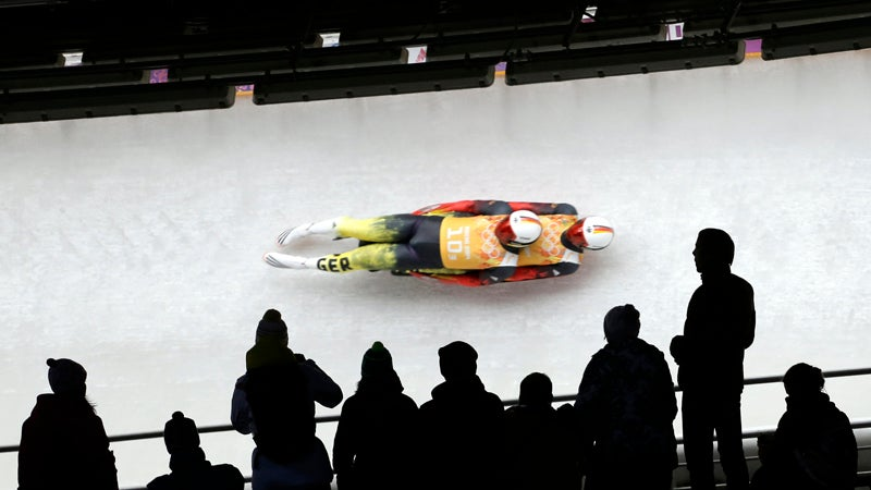 The German doubles team of Tobias Wendl and Tobias Arlt speed down the track during the luge team relay competition at the 2014 Winter Olympics, Thursday, Feb. 13, 2014, in Krasnaya Polyana, Russia. Germany won the gold medal. (AP Photo/Charlie Riedel)