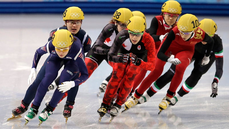 Shim Suk-Hee of South Korea, front left, Valerie Maltais of Canada, centre, and Fan Kexin of China, front right, compete in the women's 3000m short track speedskating relay final at the Iceberg Skating Palace during the 2014 Winter Olympics, Tuesday, Feb. 18, 2014, in Sochi, Russia. (AP Photo/Darron Cummings)