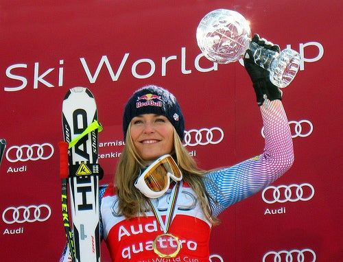 Olympic champion Lindsey Vonn holds the crystal globe she won for taking the season long Audi FIS World Cup downhill title after the final downhill race of the season in Garmisch-Partenkirchen, Germany. (Doug Haney/U.S. Ski Team)