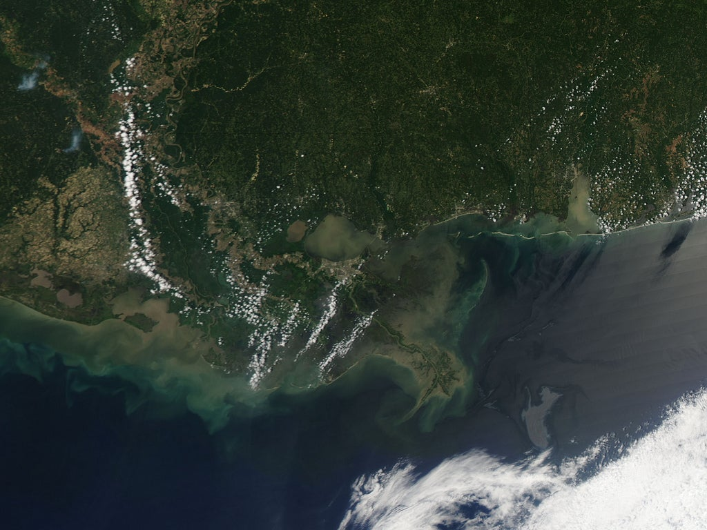 NASA satellite image acquired May 4, 2010.Two weeks after the April 20 explosion at the Deepwater Horizon rig in the Gulf of Mexico, an oil slick lingered not far from the Mississippi Delta. On May 4, 2010, the Moderate Resolution Imaging Spectroradiometer (MODIS) on NASA's Aqua satellite captured this natural-color image of the oil slick. The slick appears as an uneven gray shape immediately north of a bank of clouds. Sunlight bouncing off the ocean surface gives the oil slick a mirror-like reflection easily detected by satellite sensors. Although the oil visible in this image appears fairly distant from the coastline, NatureNews reported that the western edge of the slick had been brushing up against the Mississippi Delta since April 30. Model predictions put the oil slick near the coast of Louisiana by May 4 or 5, but changing winds pushed the oil farther away from land on May 4. Ecologists still worried, however, that the oil might drift into the path of the Loop Current, which carries warm water from the Yucatán Peninsula across the Gulf of Mexico and toward Florida. The current had the potential to spread oil to the shores to Mississippi, Alabama, the east coast of Florida, and the Florida Keys. The Pentagon approved the deployment of as many as 17,500 National Guard soldiers to assist with cleanup efforts, according to the Associated Press. Meanwhile, well operators considered drilling a relief well—a diagonal well intersecting the original that could be filled with mud or concrete to block the oil. NASA image by Jeff Schmaltz, MODIS Rapid Response Team at NASA GSFC. Caption by Michon Scott. Instrument:Terra - MODIS