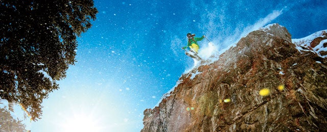 Jacqui Edgerly jumping a large cliff in the Snowbird sidecountry.