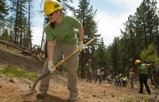 Jugita Krilaviciute, left, works the soil during the Vail Resorts Hayman Restoration Project in the Trail Creek drainage on Thursday, June 2, 2011. The Vail Resorts Hayman Restoration Project is in the second of a three year, $750,000 partnership with the U.S. Forest Service and The Rocky Mountain Field Institute to restore lands damaged by the 2002 Hayman wildfire, the largest in Colorado's history. Vail Resorts Photo by Peter M. Fredin.