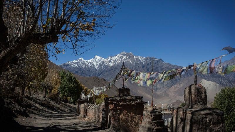 October 23, 2013 - Annapurna, Nepal - The road down through the Kali Gandaki River Valley from Muktinath to Tatopani. With views of the Annapurna Range of the Himalaya.