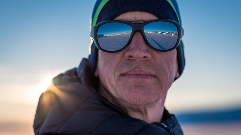 Mike Horn stares out at the Antarctic ice in his Julbo Explorer 2 glacier glasses before departing on his solo, unsupported crossing of the continent.