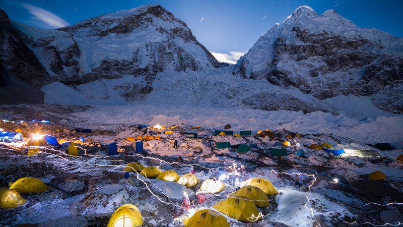 Headlamps trace through the night sky at Everest Base Camp.