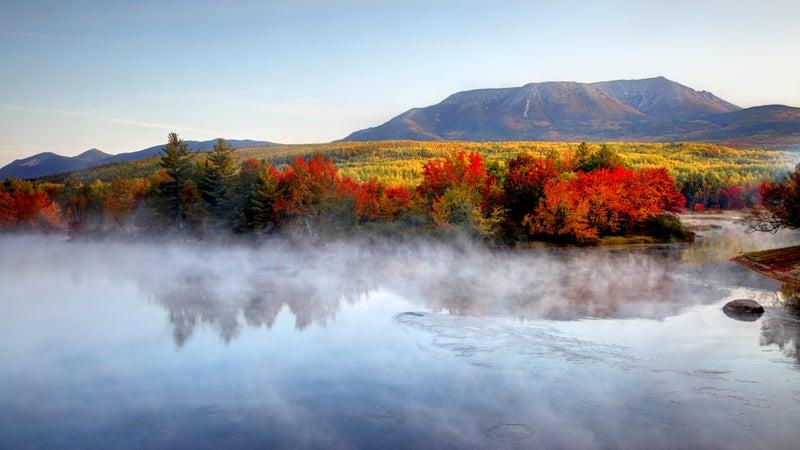 Mount Katahdin framed by Maine's legendary fall foliage.