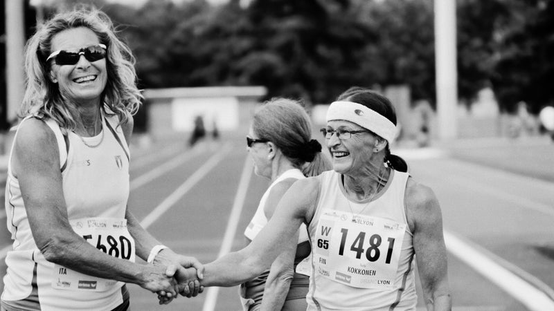 W65 masters track & field heptathletes Ingeborg Zorzi, of Italy, left, and Terhi Kikkonen, of Finland, congratulate each other at the 200-meter finish line in Venissieux, France during the 2015 World Masters Athletics Championships.