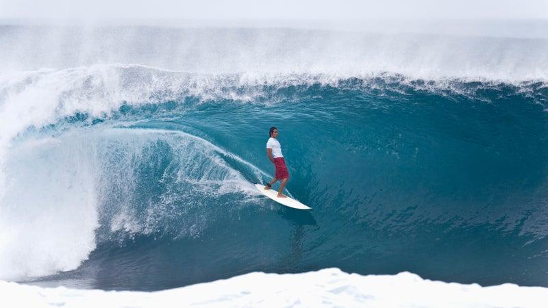 Randal Paulson surfing the barrel of Pipeline.