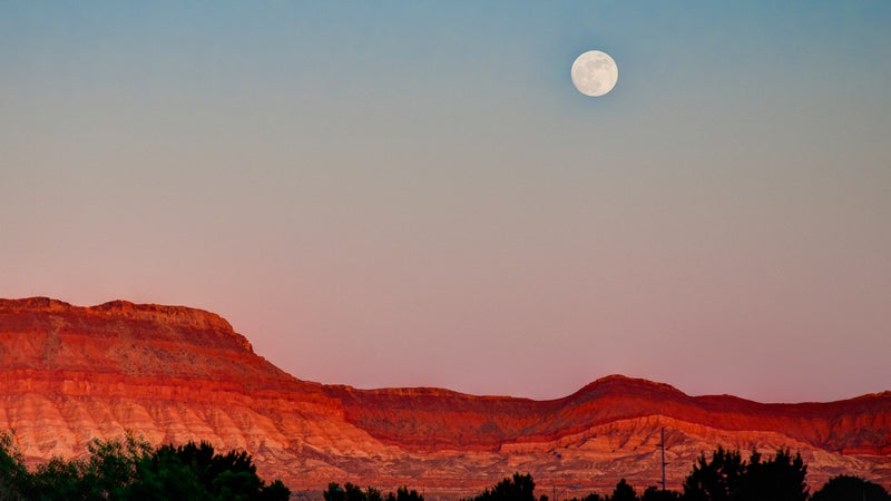 Moon hangs over St. George, Utah.