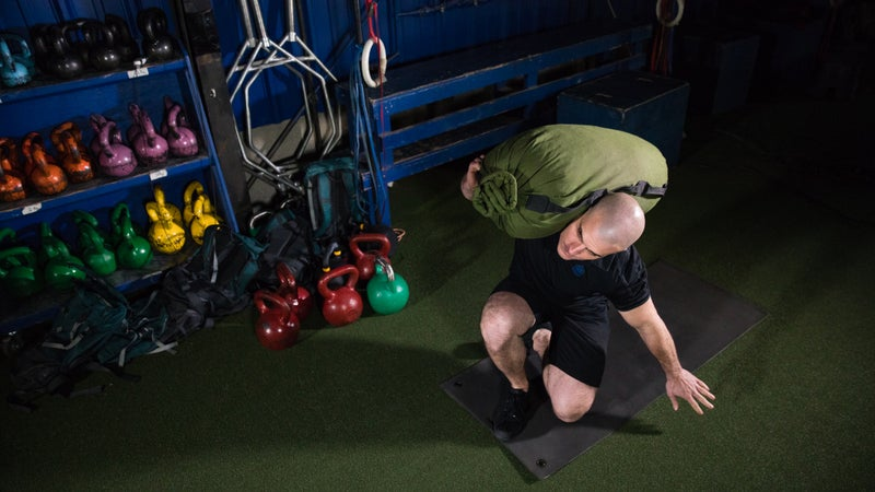 Bausman demonstrates a total body core routine at the Mountain Tactical Institute in Jackson, Wyoming.