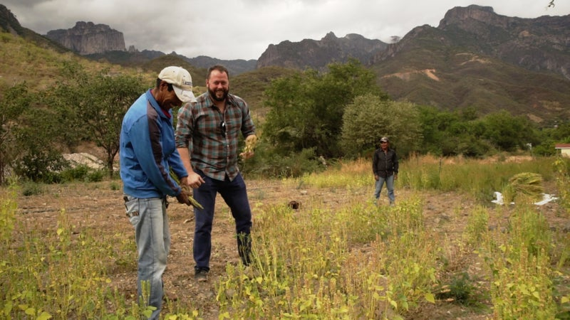 Health Warrior co-founder Shane Emmett and Silvino Cubesare in the field.