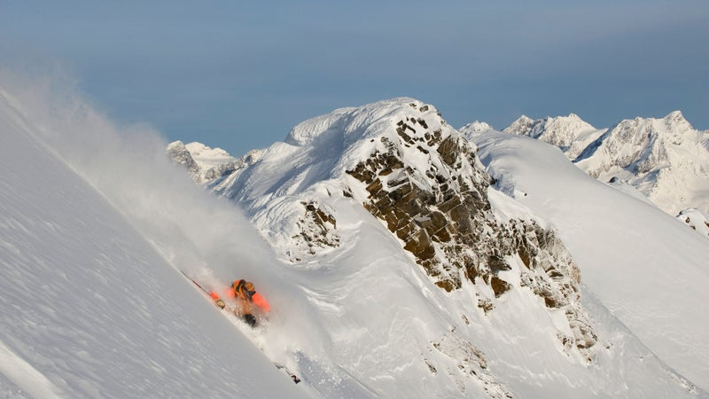 Ski guide Dave Gauley makes the first steep turns off of Jans Perch, a tiny summit in the Cariboo Mountains of British Columbia.