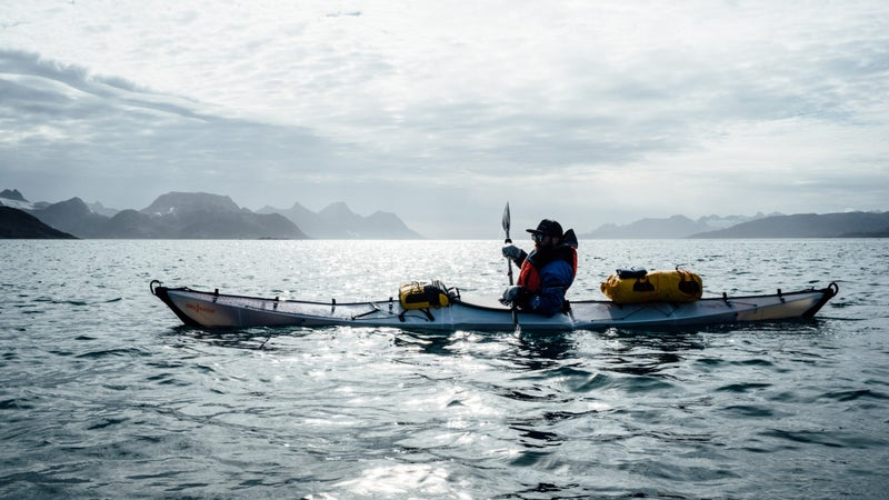 Chris paddles his Oru Coast+, loaded down with camping and mountaineering gear.