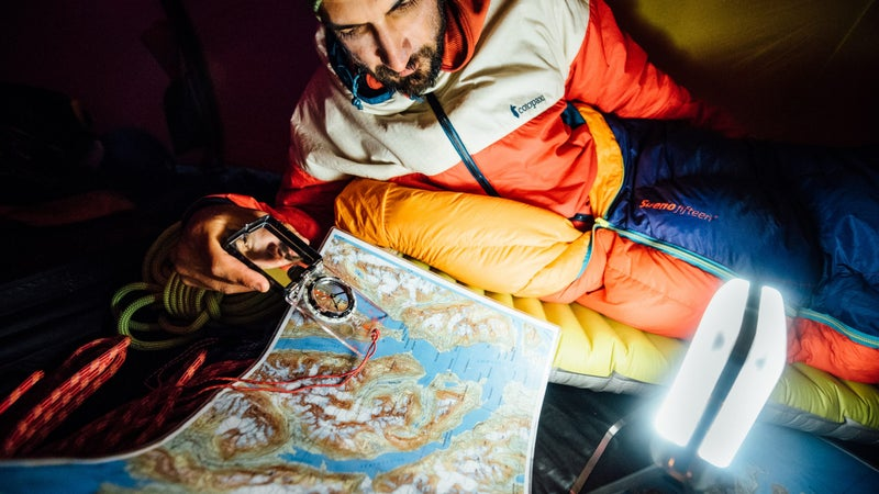 Andrew pores over a topo map in search of new climbing objectives.