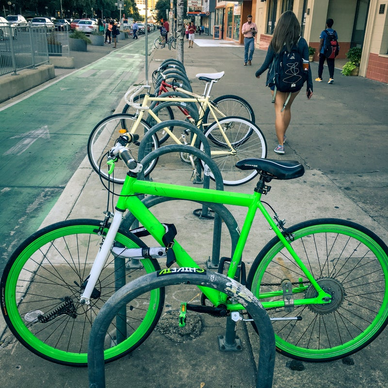 The second day of hoping this green monster gets stolen. Knog's Strongman U-lock is around the rack and bike frame. The Hiplok Superbright is around the front wheel, frame, and bike rack.