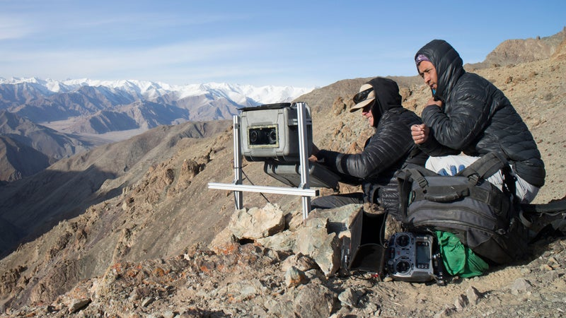 In Ladakh, India, the local team set up and check on a camera trap positioned on a route frequently used by snow leopards crossing these mountains.