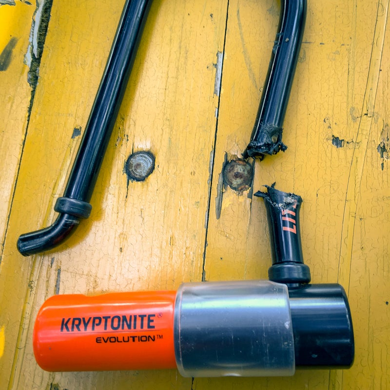 The Kryptonite Evolution LITE Mini-6 U-lock after an ugly meeting with an angle grinder.
