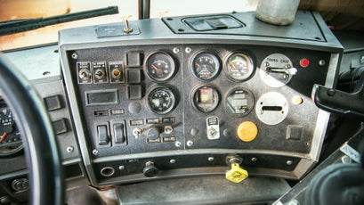 The dashboard of a Mack snowplow truck—though stuffed into a small cabin, is packed with gauges and switches for everything from surface temperature monitoring and air filter restriction to manual transfer case lockup.