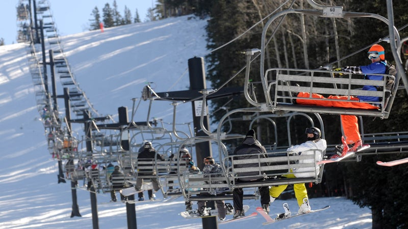 Chairlifts at the Arizona Snowbowl near Flagstaff, Arizona carry skiers uphill.