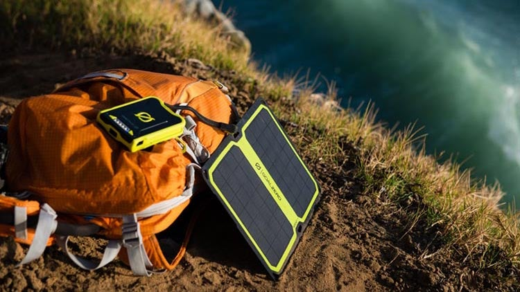 We get the appeal of clean, off-grid power, but the reality just hasn't caught up with your imagination yet. You're way better off just carrying a cheap battery pack.