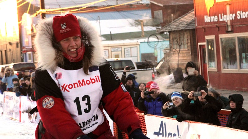Zirkle drives her team to the Nome finish line of the 2016 Iditarod after she was attacked by a snowmobile driver in an isolated stretch of the route.