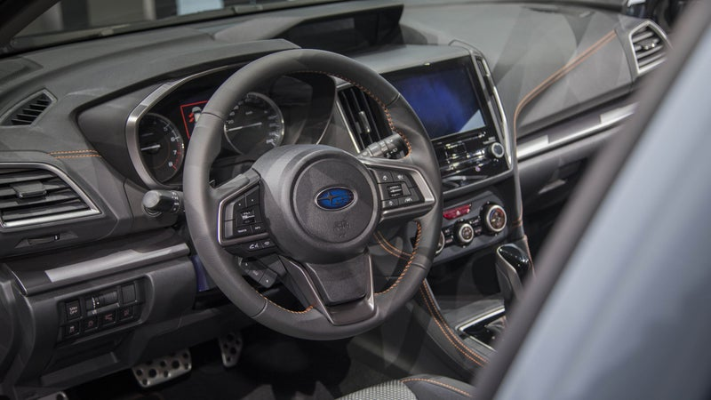 The interior gets a fancy new touchscreen, as well as nicer materials. Orange stitching separates the Crosstrek interior from that of the regular Impreza.