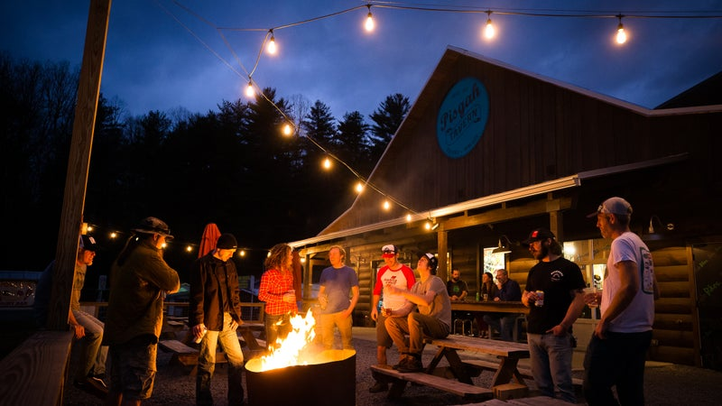 A timeless pastime—beers around a fire at Brevard's Hub.