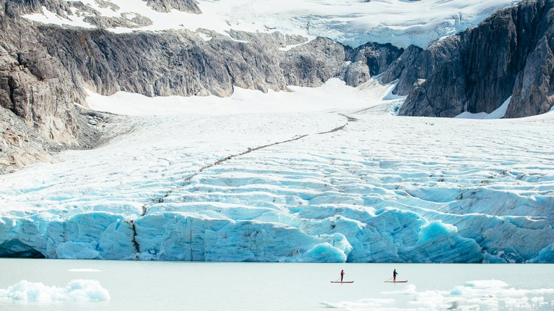 Stand up paddleboarding past a glacier in Nimmo Bay, BC.