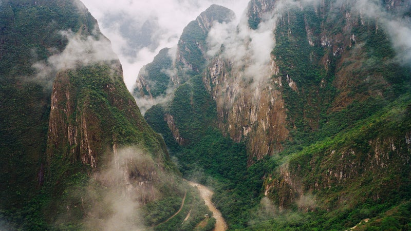 A view of foggy mountains in Machu Picchu.