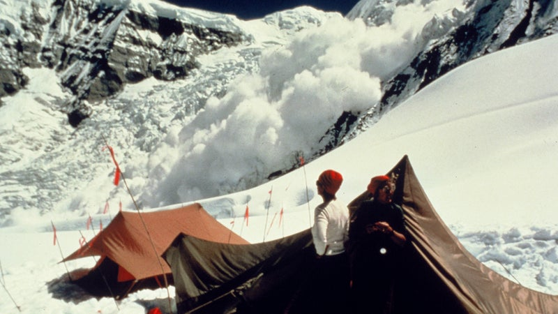 Blum watching one of the frequent avalanches that threatened the expedition