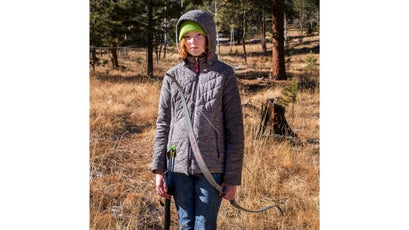 Nicole McCloskey, 12,  poses for a portrait on the archery range.