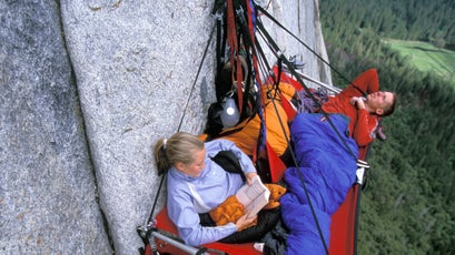 Beth Rodden and Tommy Caldwell take a break on a porta-ledge on the West Buttress of El Capitan.