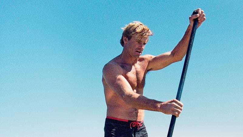 """""""We start going downhill as soon as we stop taking risks,"""" says Hamilton, shown here paddleboarding near Malibu."""