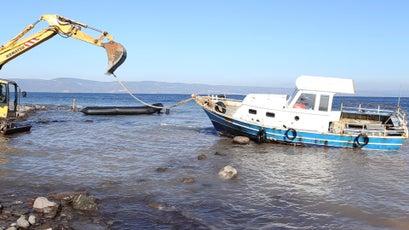 Refugee boats being destroyed.