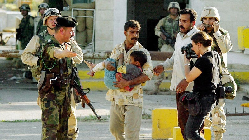 Addario photographing an Iraqi man in Kirkuk as he is denied entry to an American-run hospital after the boy sustained a bullet injury.