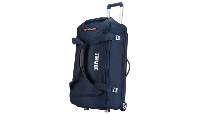 Large capacity gear bag with a wide mouth access to easily load helmets, boots, gloves, jackets and other travel essentials.