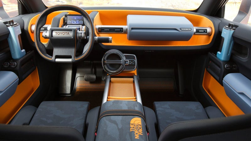 Here you can see the water bottle door handles, and sleeping bag arm rest. That big twist-handle on the radio is a tactile theme continued throughout the car, but if you twist this one, the rechargeable radio pulls out, so you can play music in camp.
