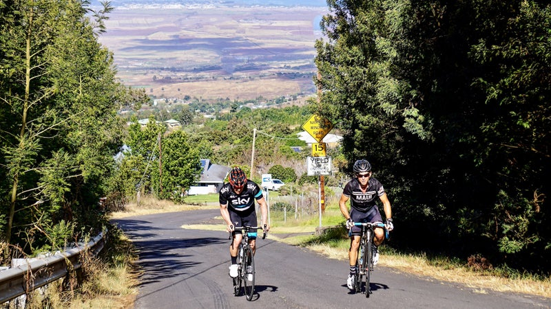 Donnie Arnoult, owner of the Maui Cyclery and Go Ride Maui, on a climb with a client.
