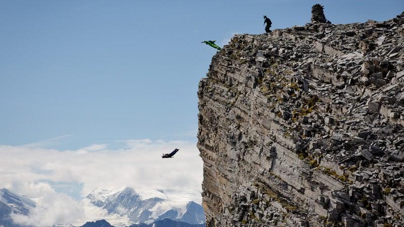 Kat Donahue, Scotty Bob Morgan, and Hartman Rector jump near Lauterbrunnen Valley.