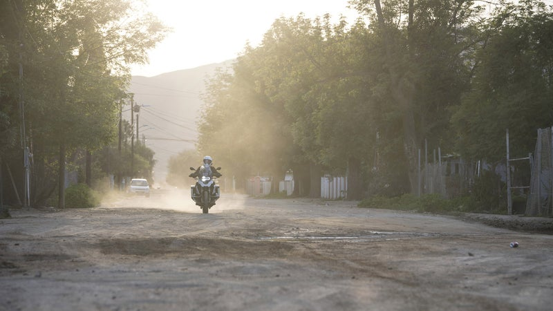 Just an average neighborhood street in Baja. Would you really want to ride a Harley down this?