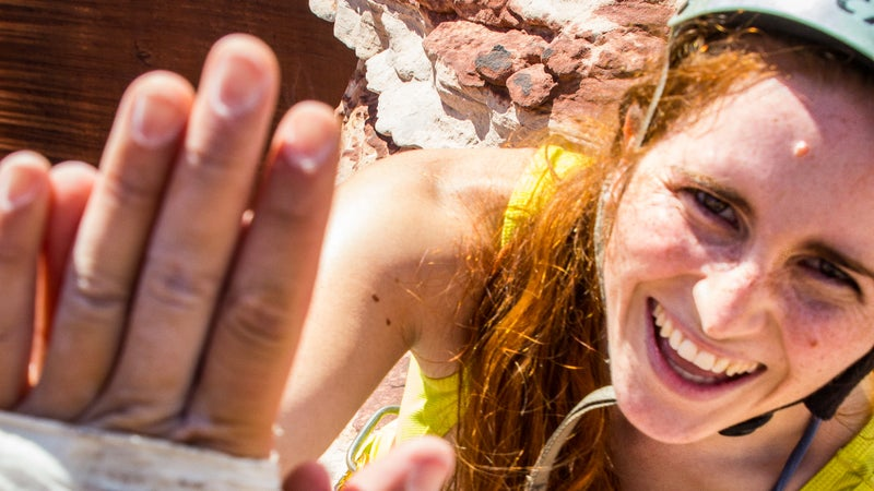 Caitlin McNulty (@seecaitclimb) gets a high five from Yee after completing her climb.