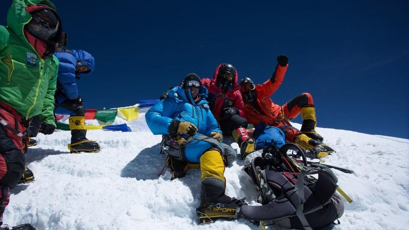 The Alpine Ascents team at the summit of Everest.