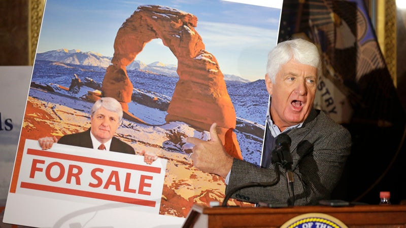 Rob Bishop holds an image he says is misleading while speaking during a news conference at the Utah State Capitol, January 20, 2016, in Salt Lake City.