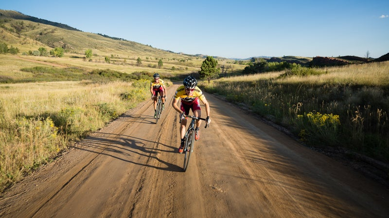 Professional cyclists Allen Krughoff and Meredith Miller ride their cyclocross bikes outside of Fort Collins, Colorado.
