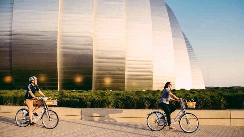 Biking past the Kauffman Center for the Performing Arts in Kansas City, Missouri.