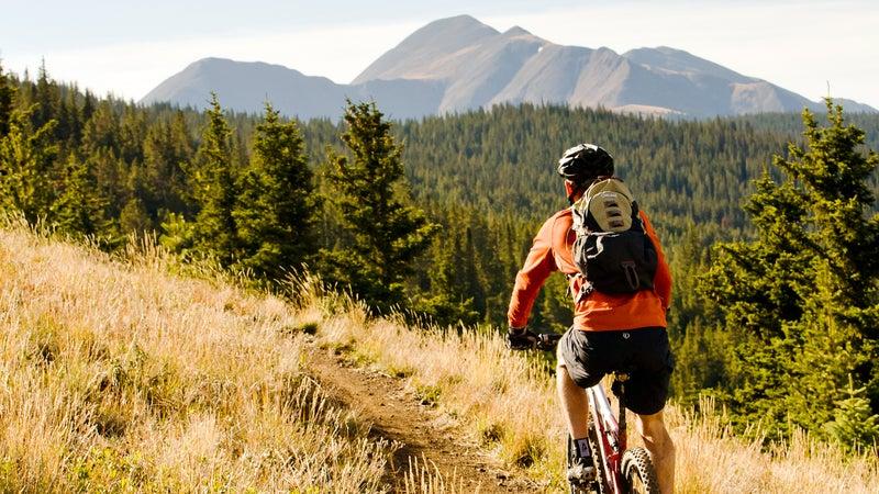 Mountain biking on singletrack on the Monarch Crest Trail outside of Salida, Colorado.